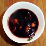 blood orange and black cherry pudding with kumquats
