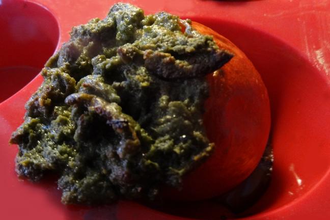 oven-roasted nettle-stuffed tomato