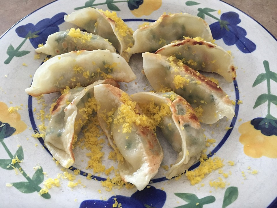 Shaved cured duck yolk over shrimp gyoza